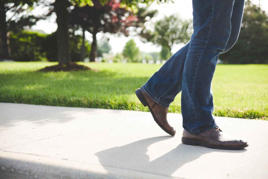 man walking in park legs