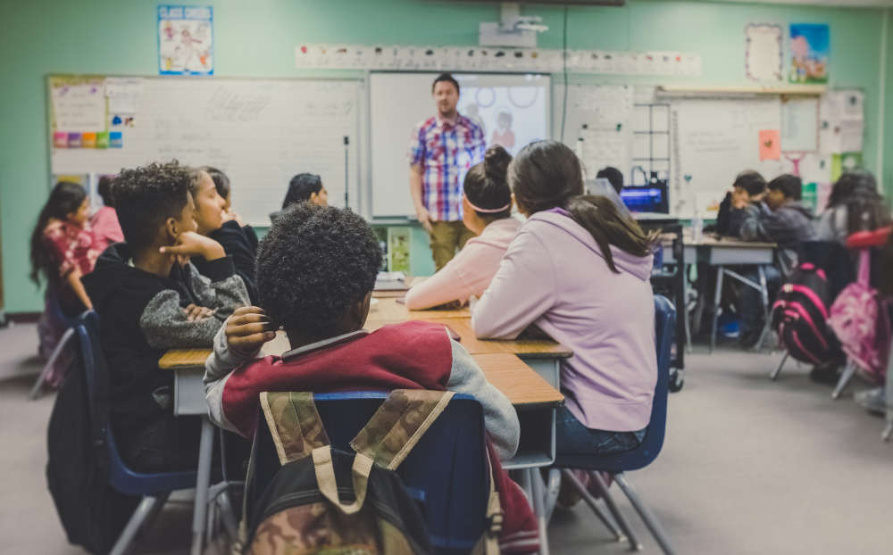 teacher in classroom with children