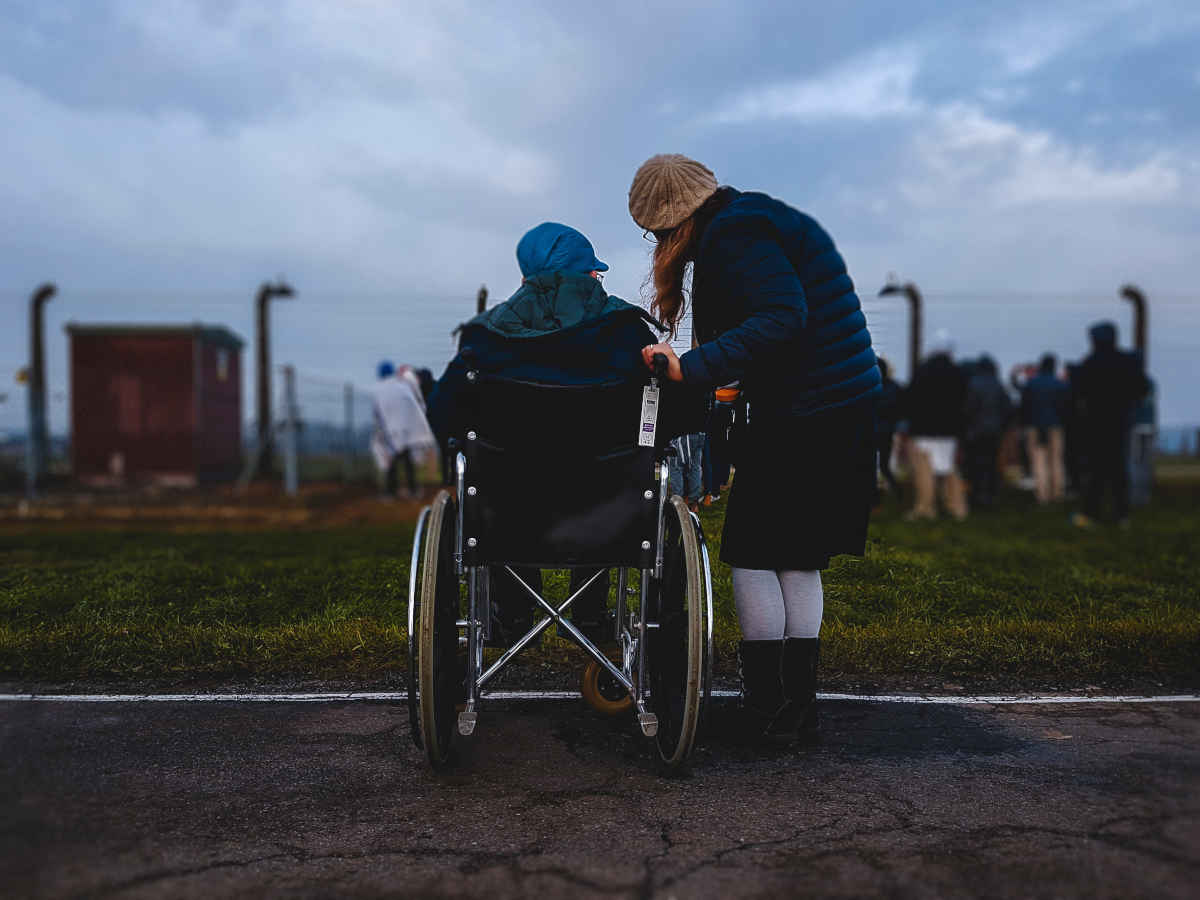 girl with person in wheelchair